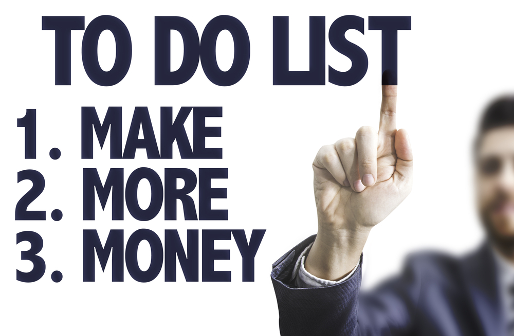 Business man pointing the text To Do List - Make More Money